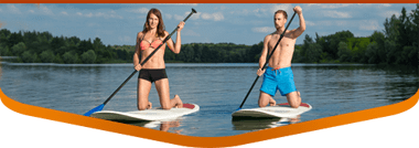 woman and man renting paddle boards